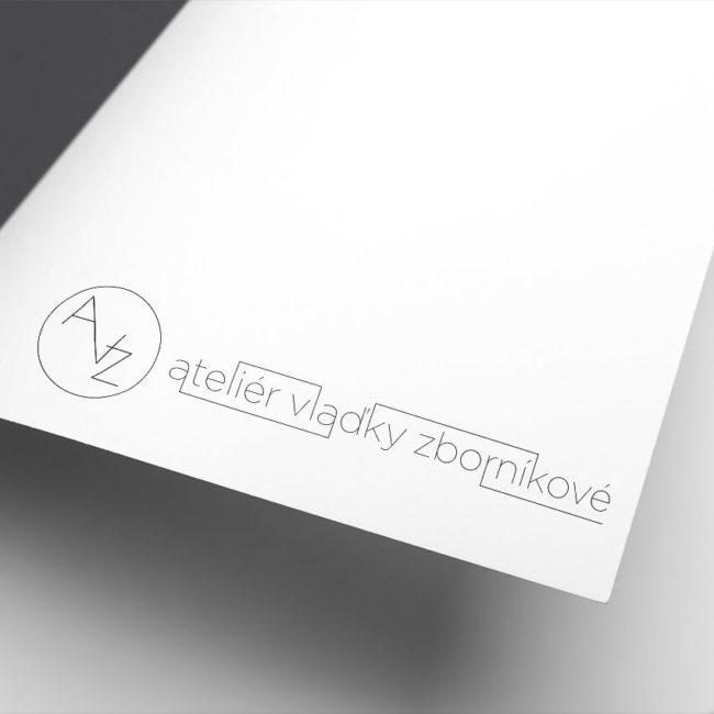 Černobílé logo ateliéru Vlaďky Z. na listu papíru.