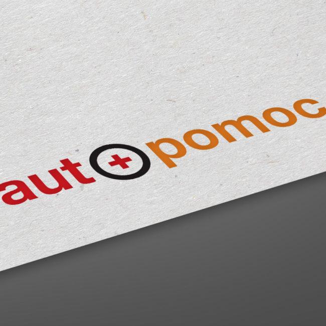 Červenooranžové logo s černým kroužkem společnosti Auto pomoc na listu papíru.